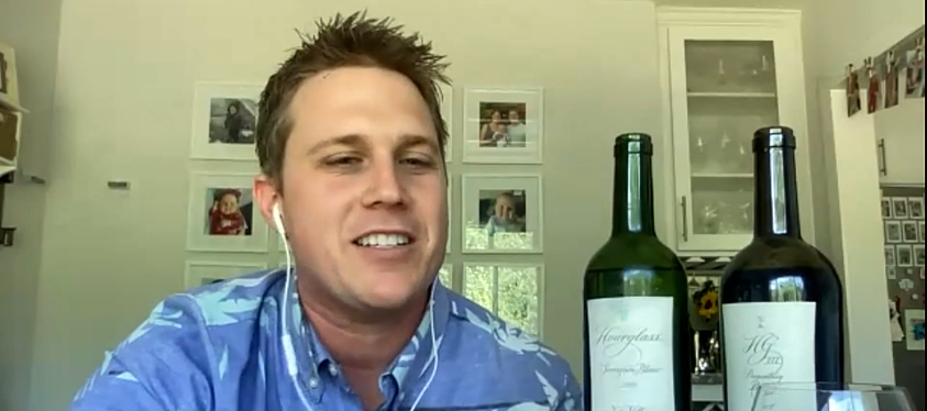 Tribe Dynamics Co-founder Conor Begley enjoys a glass of Hourglass wine at the Earned Executive Learnings Virtual Event.