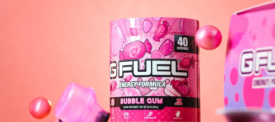 A container of bubble-gum-flavored GFuel energy formula in front of a pink background, by Jacob Rubich.
