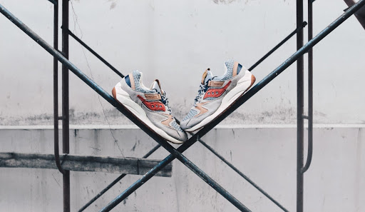 Saucony running shoes balancing on scaffolding.