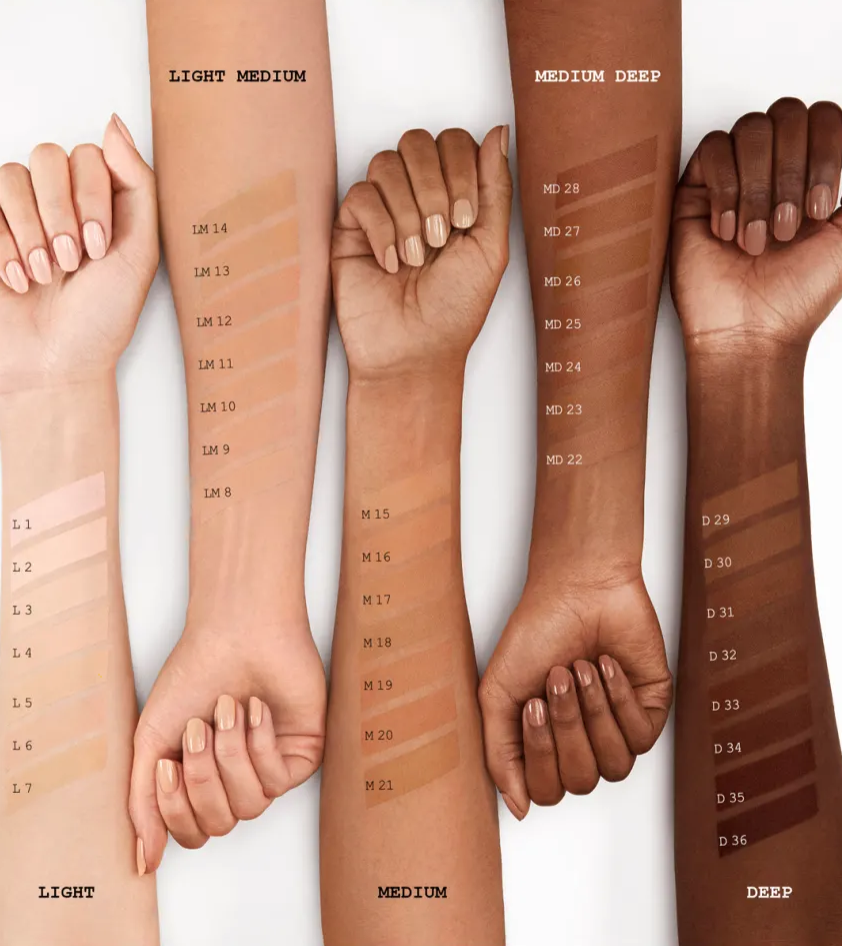 Arms of various skin tones displaying swatches of Pat McGrath Labs' Skin Fetish: Sublime Perfection Foundation