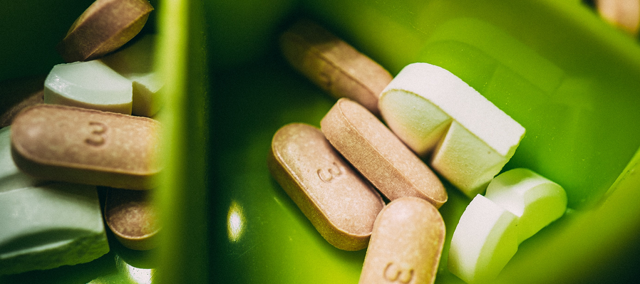 Supplements in a green container.