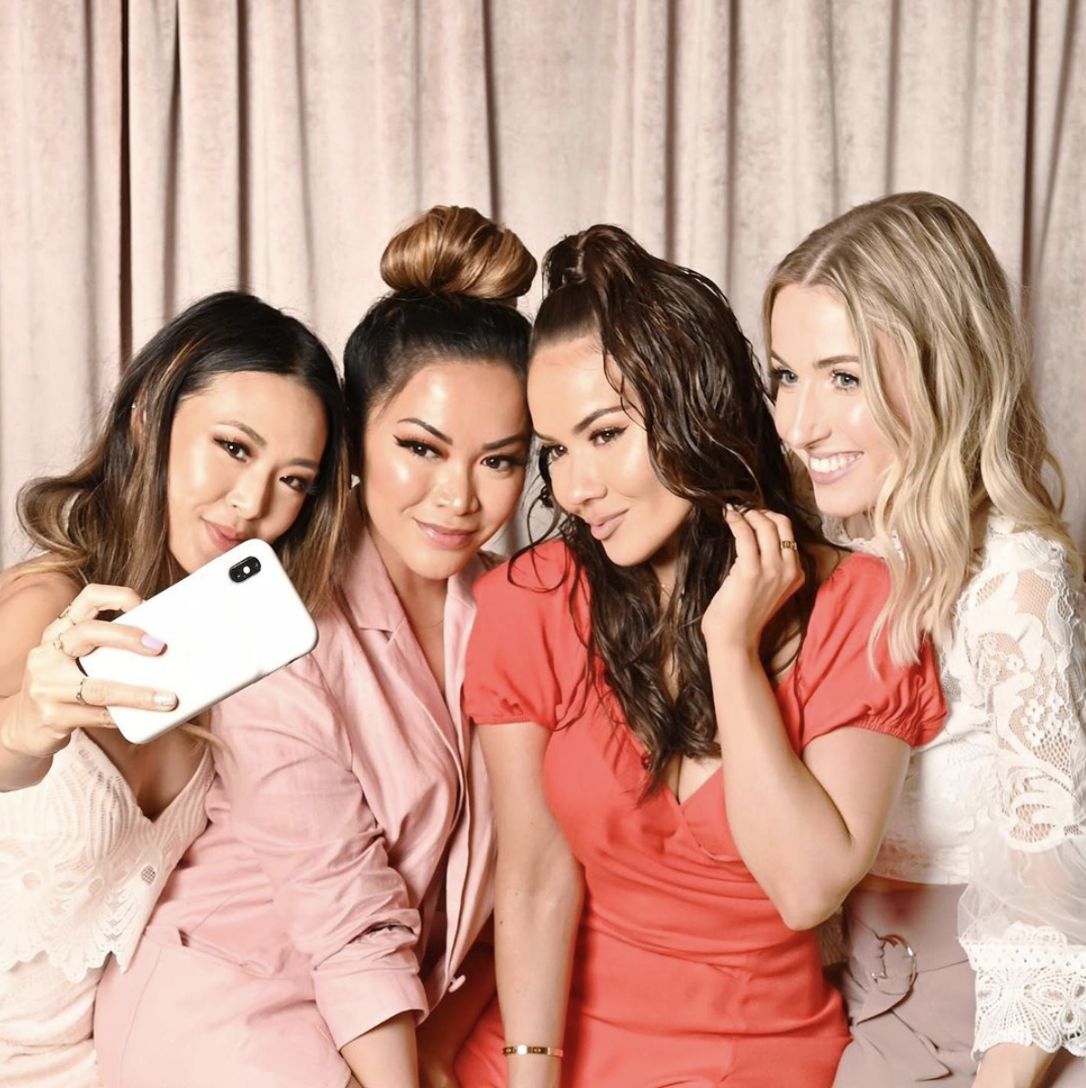 A photo of four bloggers—@frmheadtotoe, @thatsheart, @maryamnyc, and @rachhloves—taking a selfie at a Pixi Beauty event.