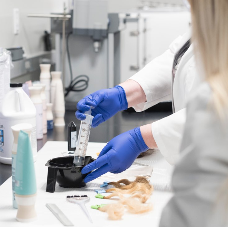 A scientist extracting Alpha Keratin 60ku in a lab that produces Virtue haircare offerings.