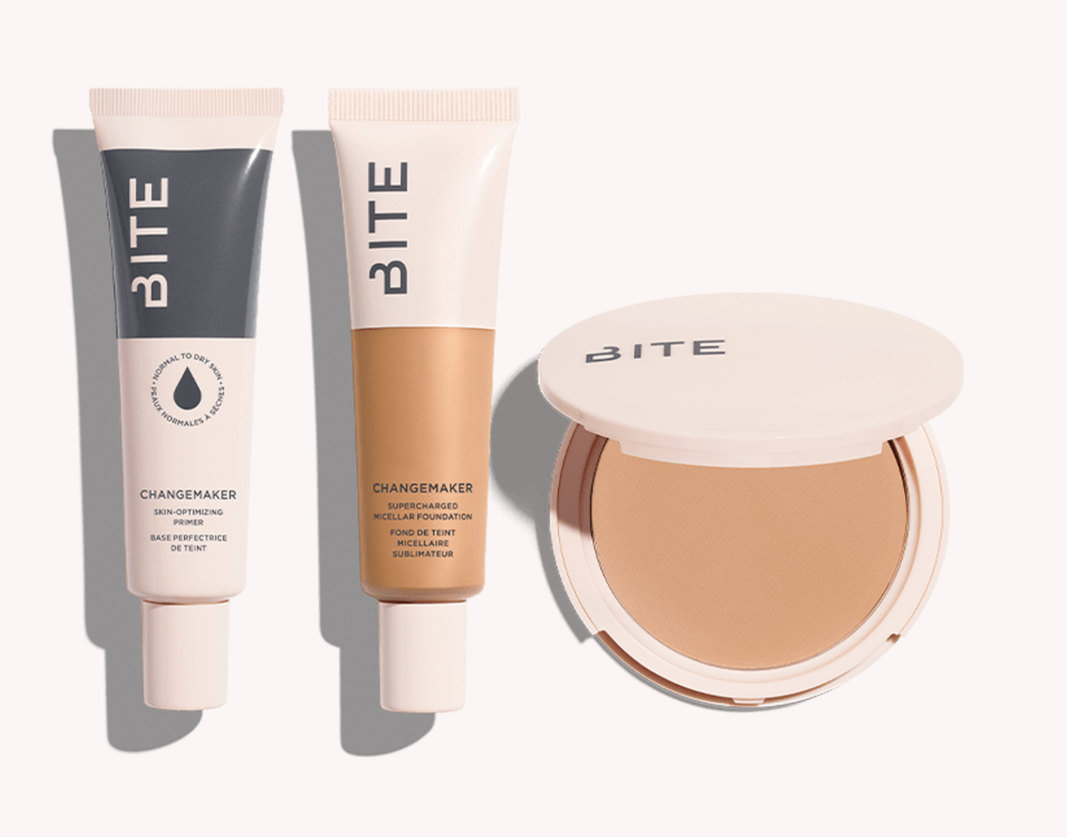 A flat-lay featuring Bite Beauty's new Changemaker Complexion System of foundation and primer products.