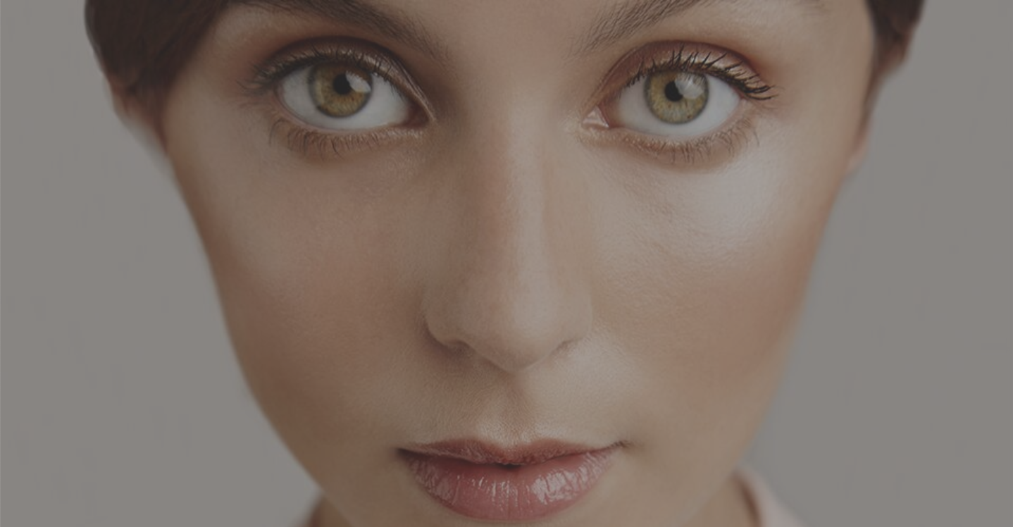 A close-up photo advertisement of a woman's face from clean beauty brand W3LL People's website.