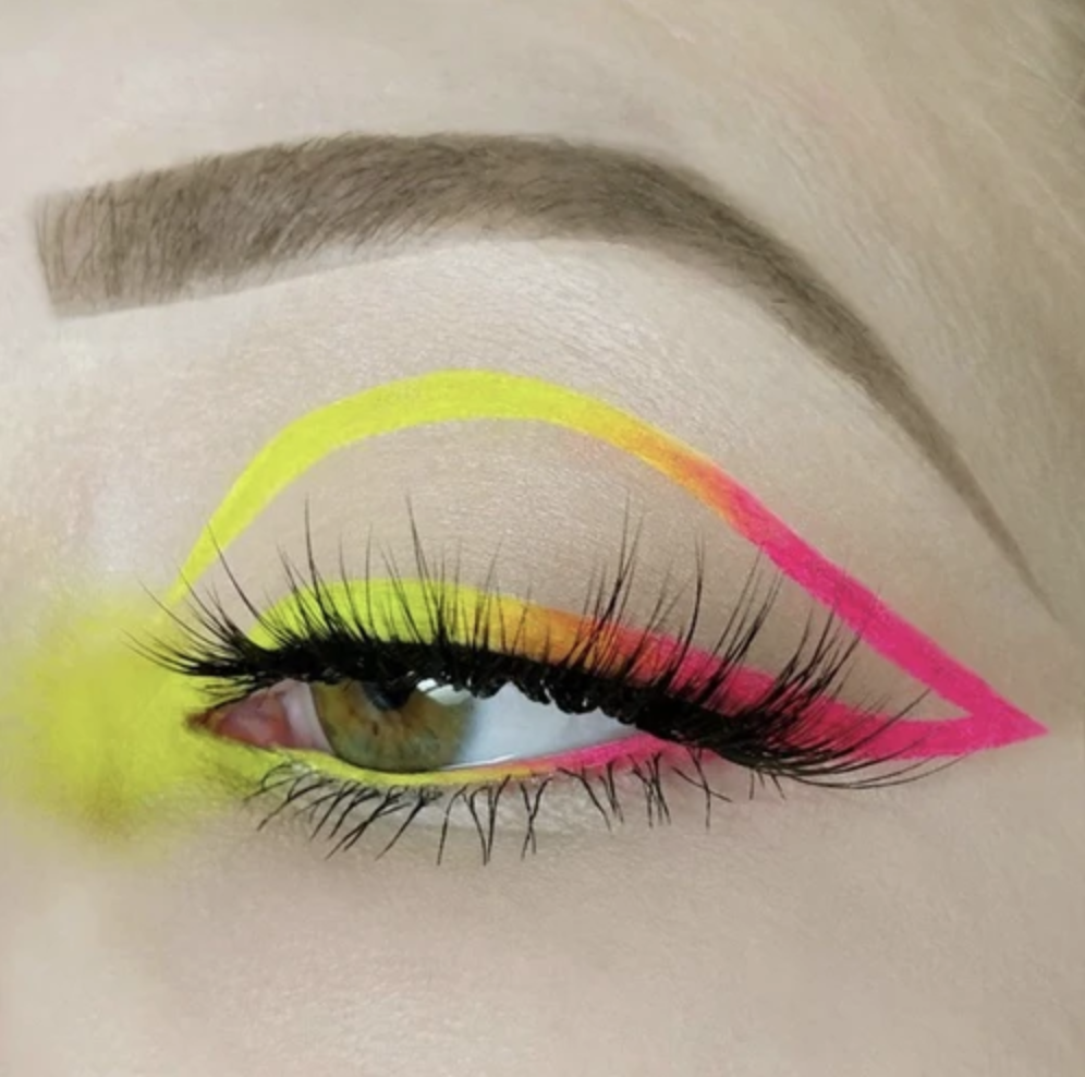 An ad for Unicorn Cosmetics featuring a close-up shot of a model wearing vivid eyeshadow.