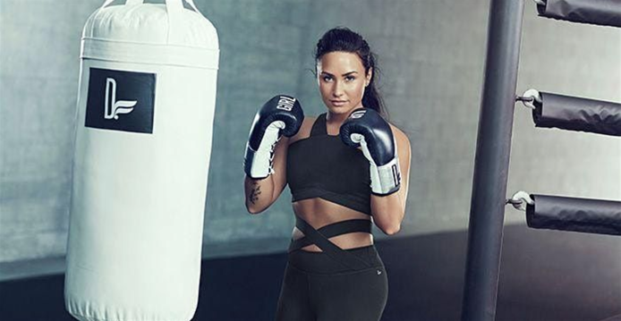 A model poses in a boxing-themed advertisement for Fabletics.