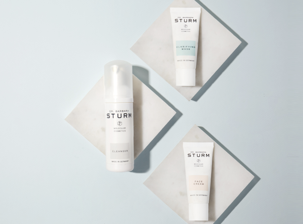 A photo featuring three of Dr. Barbara Sturm products: the Cleanser, Face Cream, and Clarifying Mask.