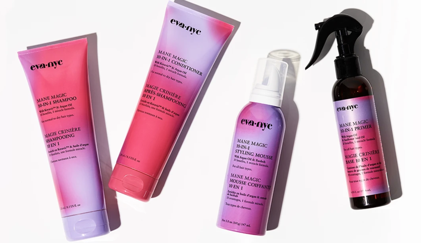 A flat-lay photo featuring products from Eva NYC's 10-in-1 haircare line.