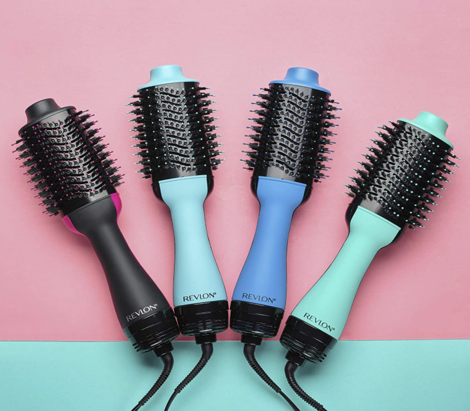 A flat-lay featuring four of Revlon's Salon One-Step Hair Dryer and Volumizer in a variety of colors.