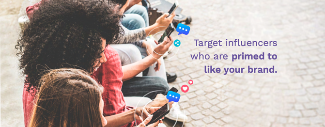 "A photograph of a line of people all looking at their phones with the text ""Target influencers who are primed to like your brand"" superimposed in purple text."