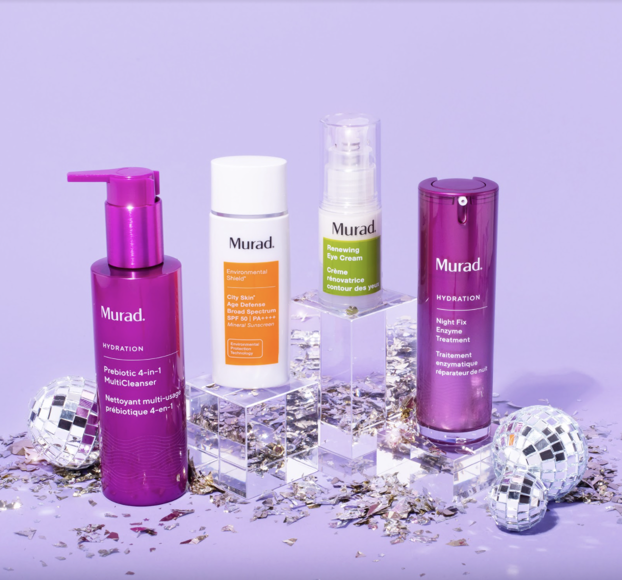 Various Murad clean skincare products arranged with miniature disco balls.