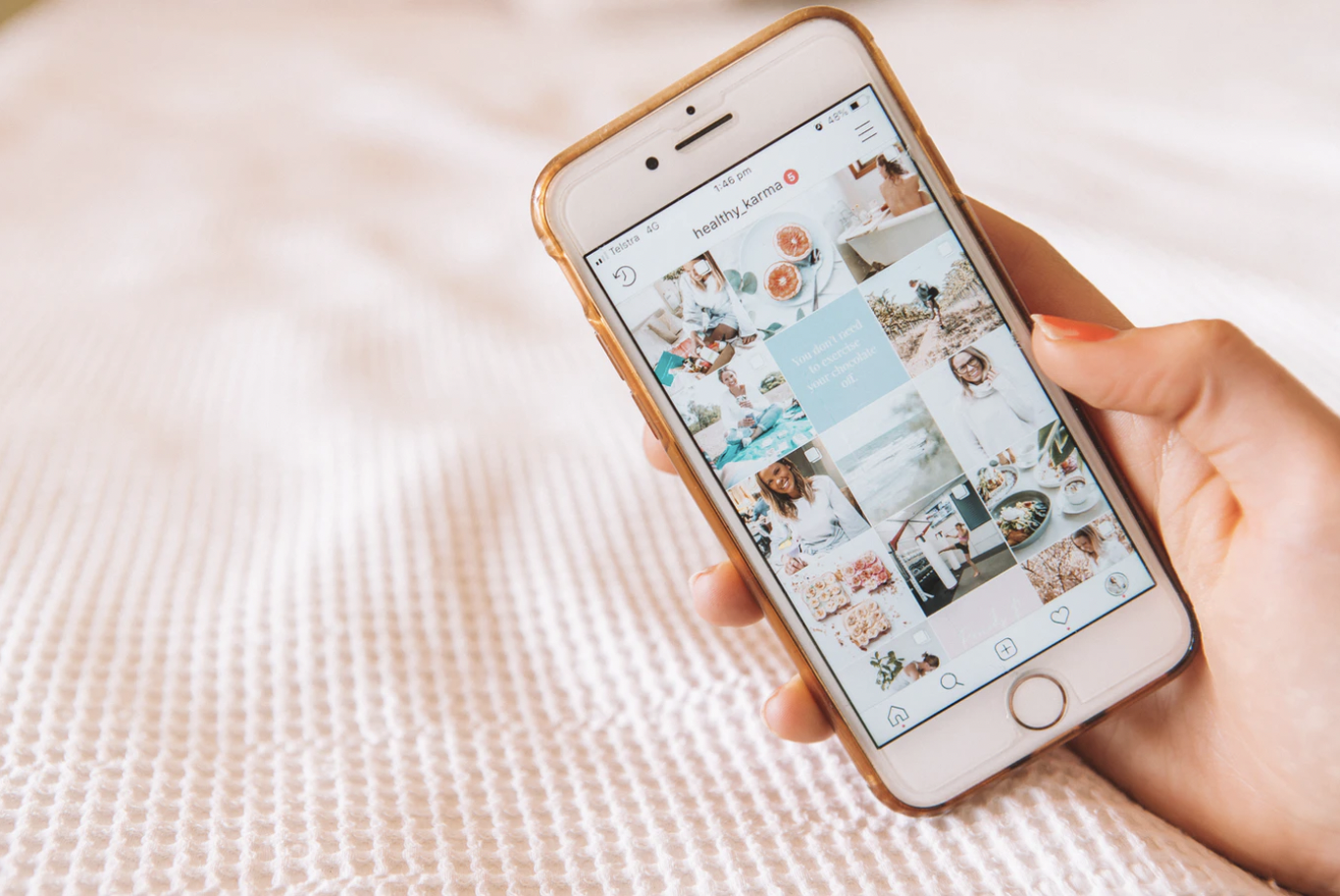 A photo by Maddi Bazzocco of an iPhone displaying an influencer's Instagram feed.