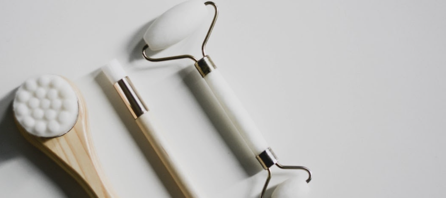 Skincare tools against a white background, by Content Pixie.