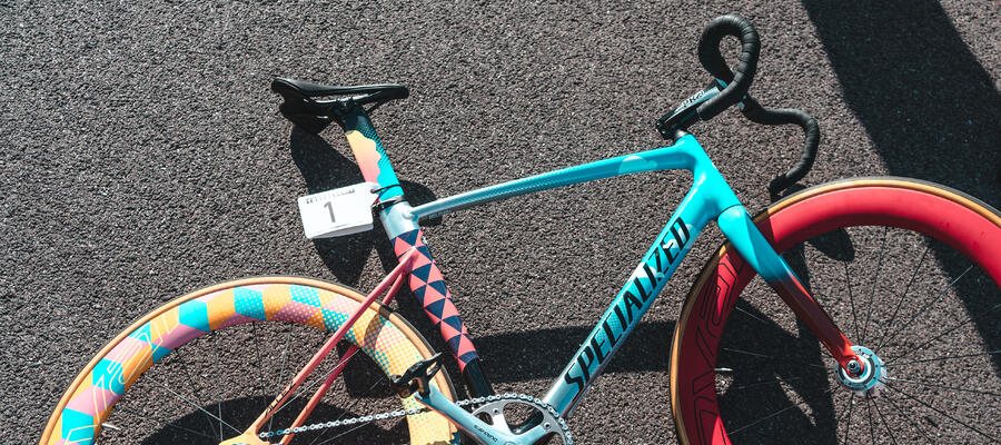A colorful Specialized bicycle placed down on the tarmac.