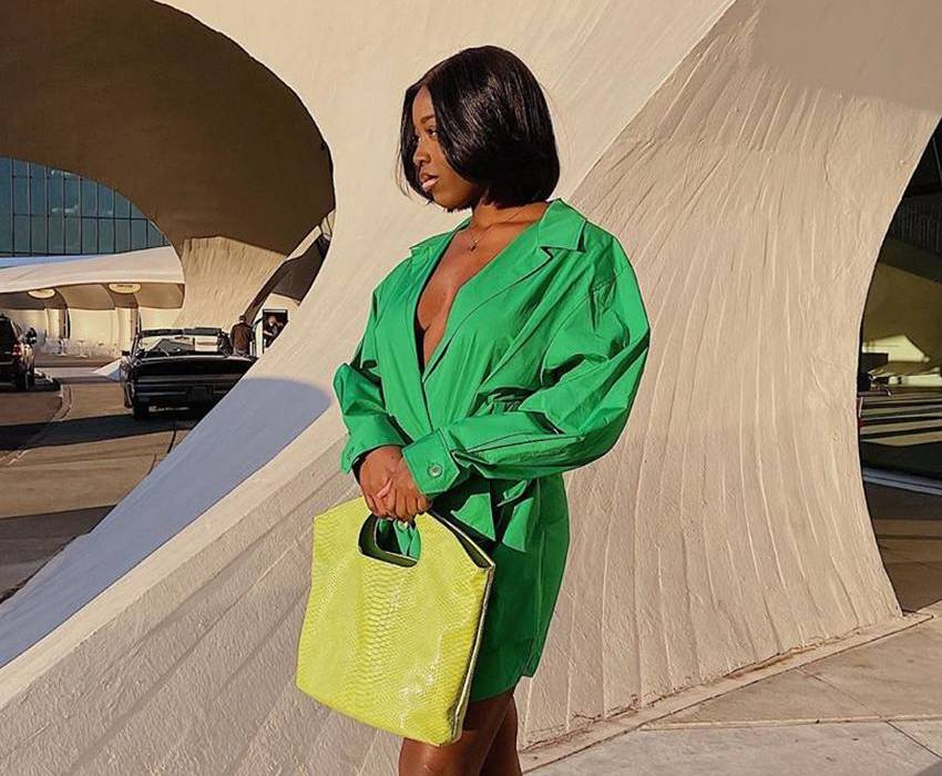 Luxury fashion influencer Nana Agyemang shows off an outfit.