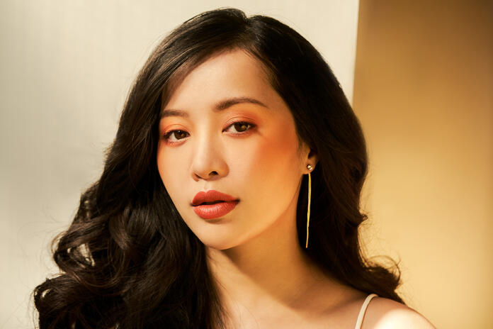 A portrait of EM Cosmetics founder Michelle Phan.