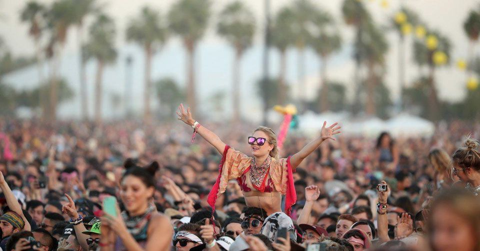 A crowd of young people partying at the Coachella Music Festival.