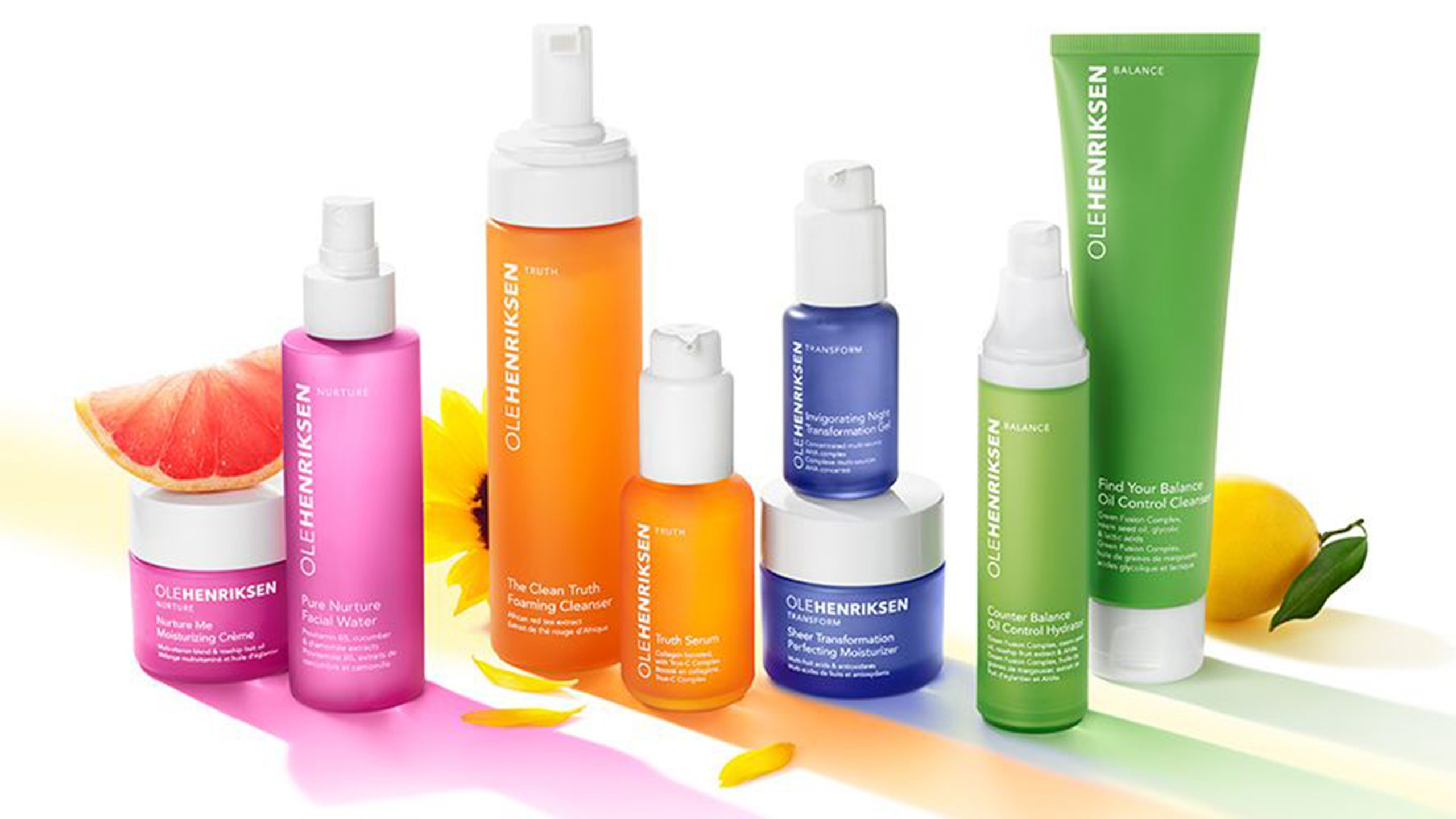 A colorful array of Ole Henriksen products with fruit.