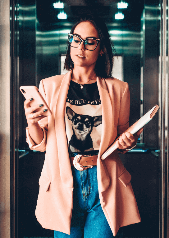 woman-holding-phone-and-planner-1