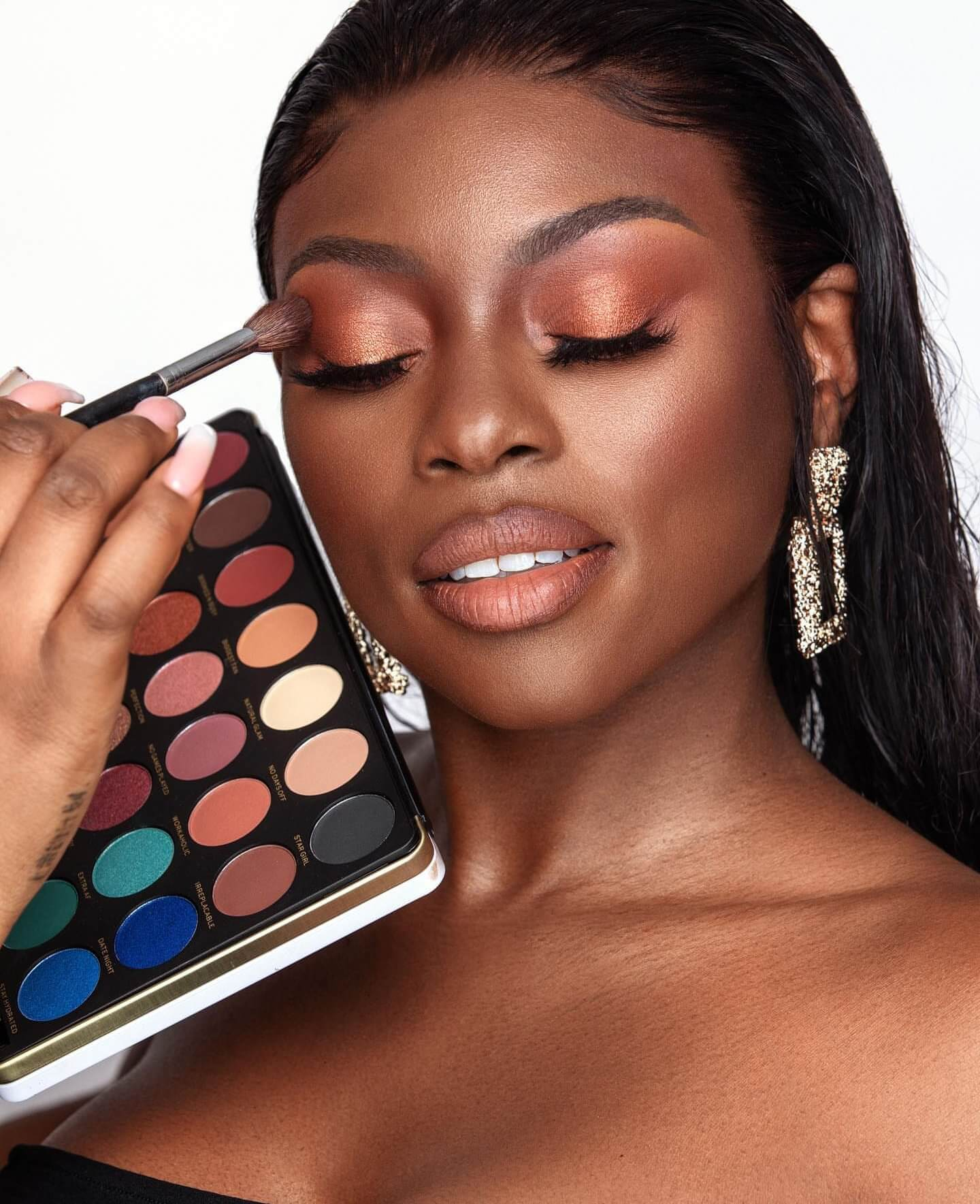 Beauty blogger Patricia Bright applies eyeshadow from her collaborative collection with Revolution Beauty.