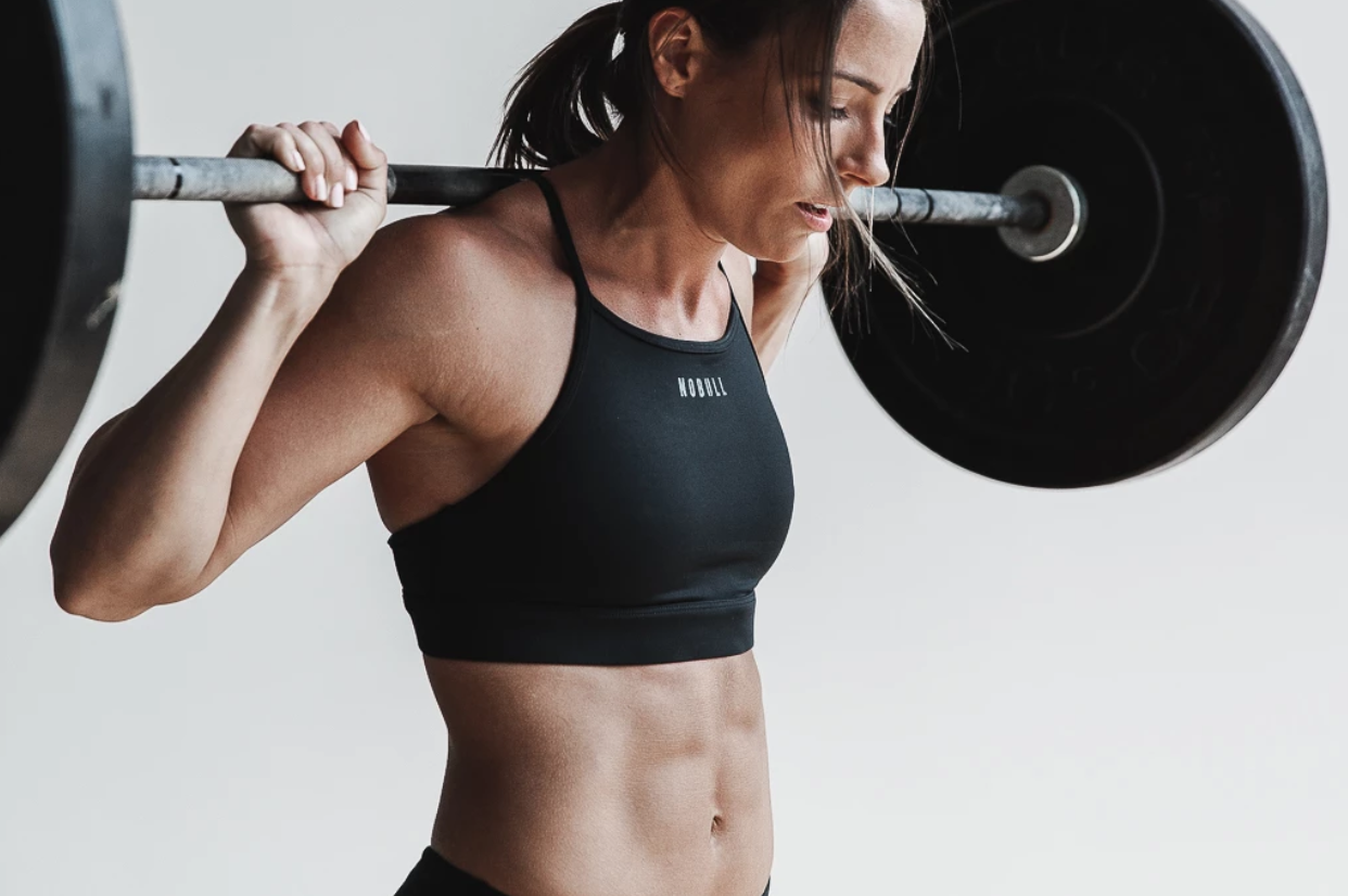 A Crossfit athlete poses in an ad for activewear brand NOBULL.