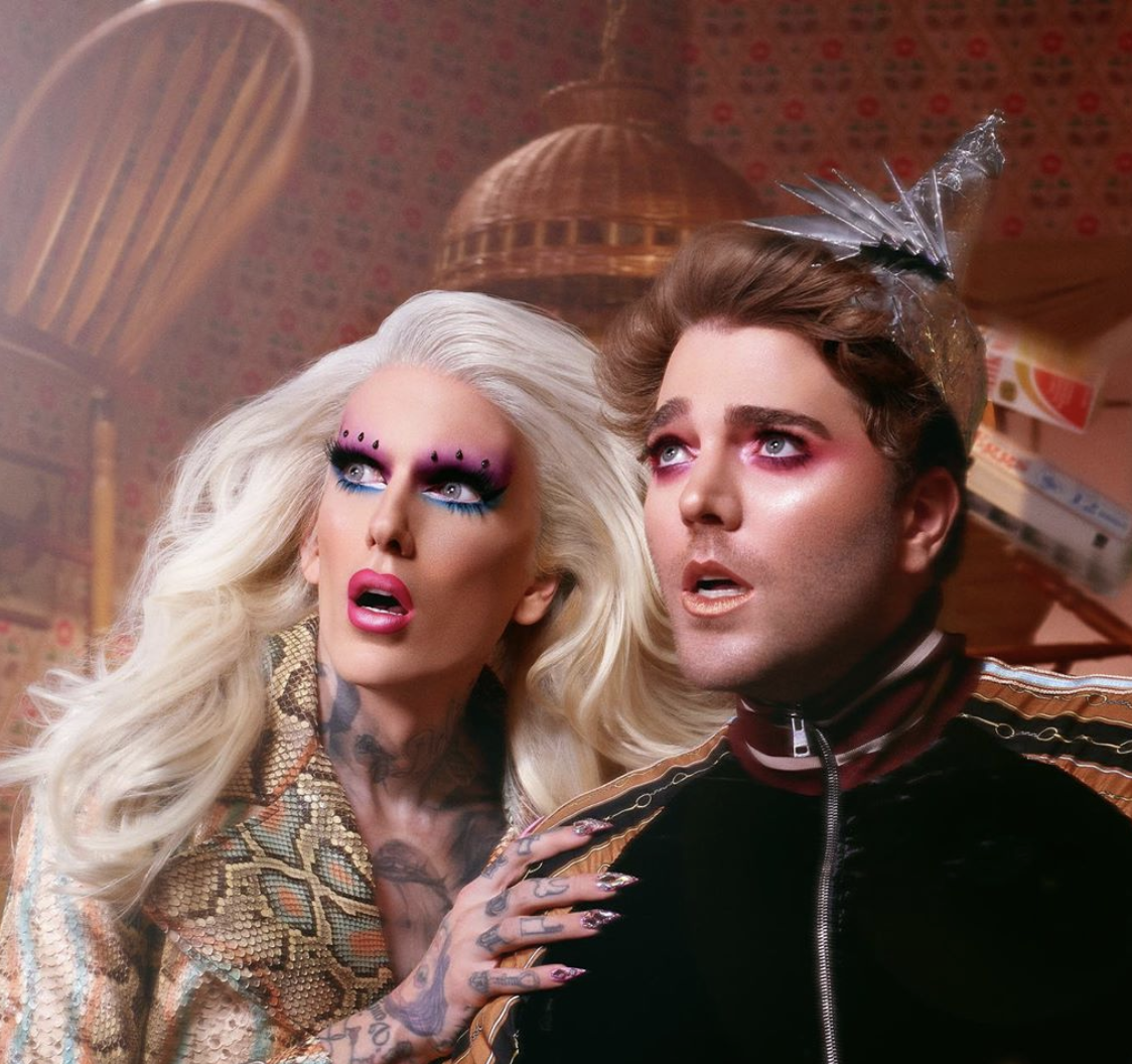 An advertisement for Jeffree Star Cosmetics' Shane x Jeffree Conspiracy Collection, featuring YouTubers Jeffree Star and Shane Dawson.