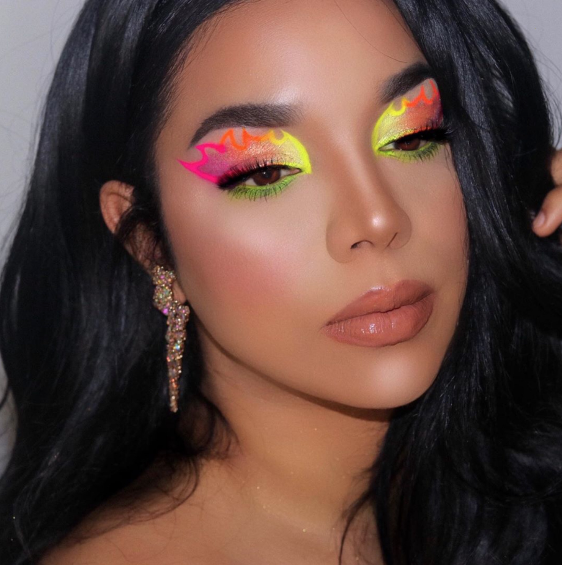 A model shows off a vibrant makeup look created with Suva Beauty products.