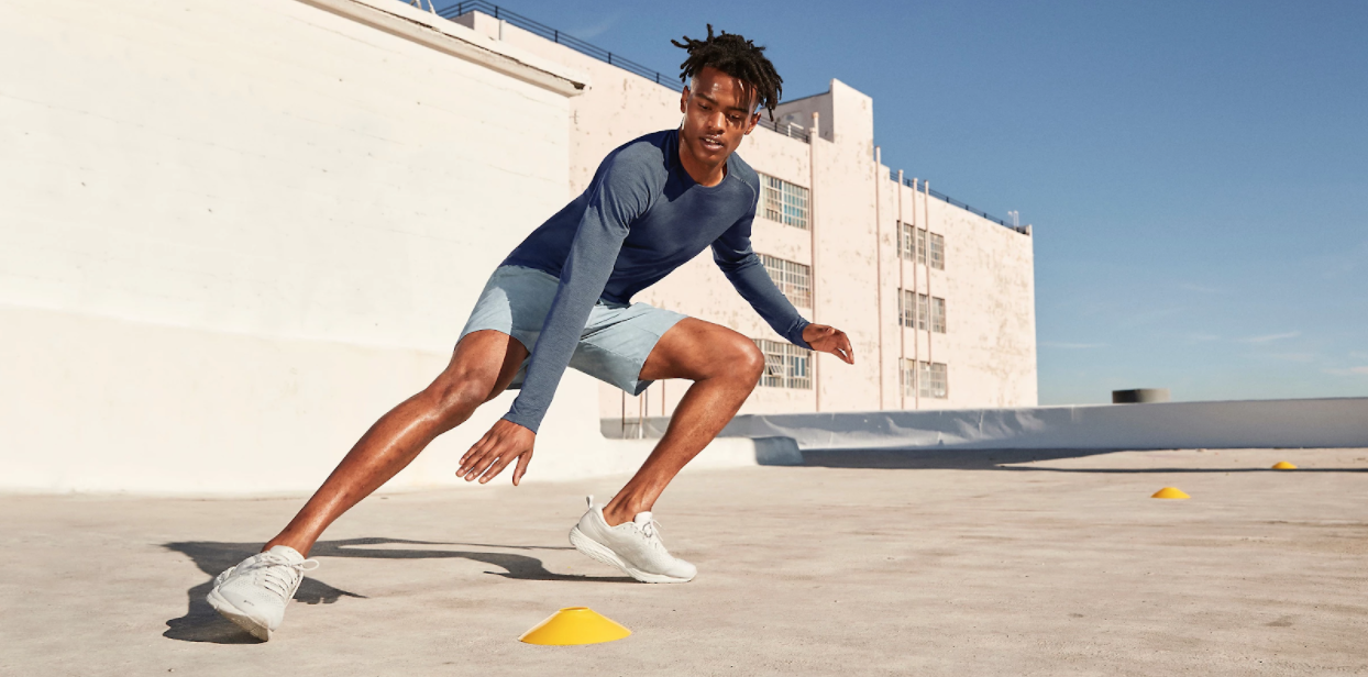 A male model running an exercise drill in an ad for Lululemon.