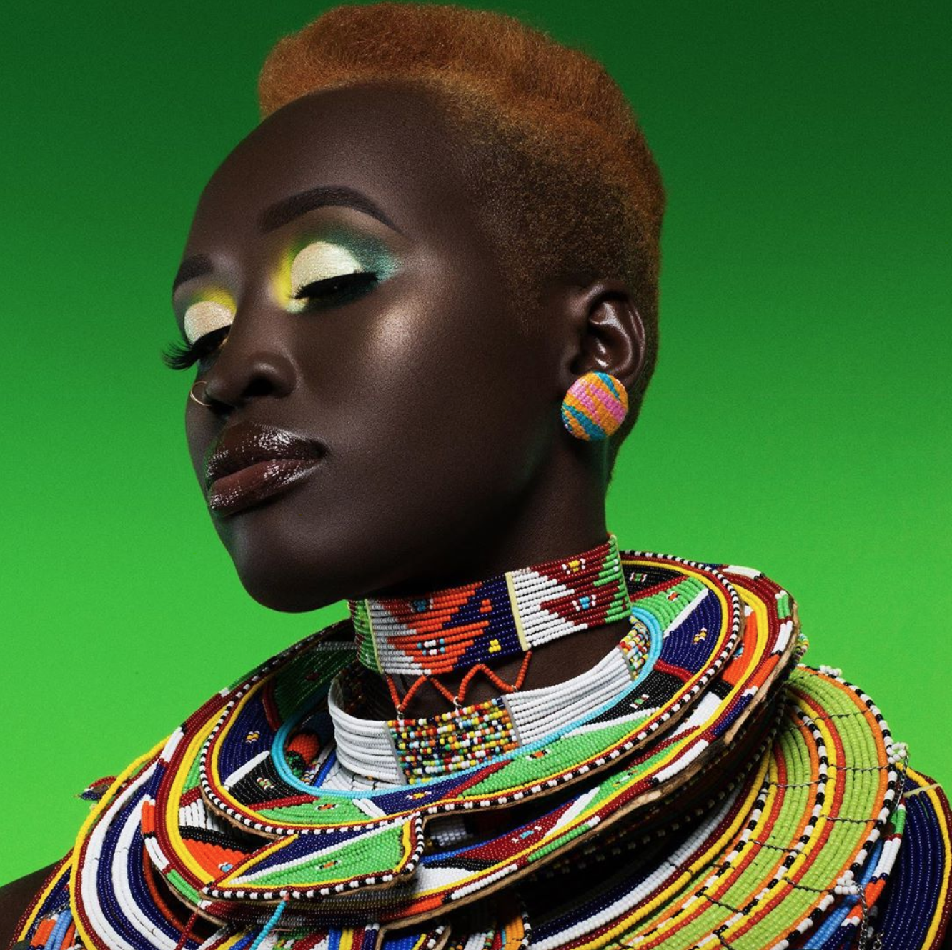 A model poses in a vibrant, colorful advertisement for Juvia's Place.