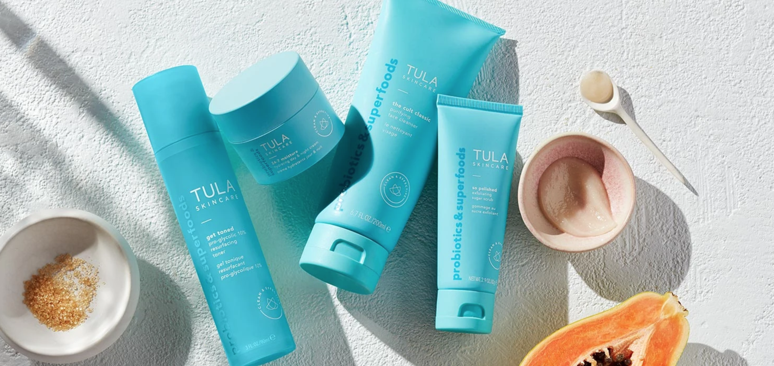 A flat-lay photo featuring products from TULA.