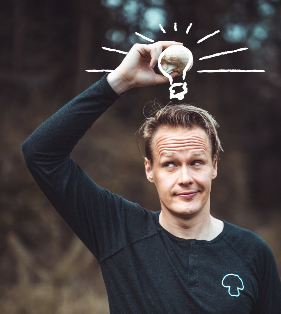 Four Sigmatic founder Tero Isokauppila poses with a mushroom in a promotional image.