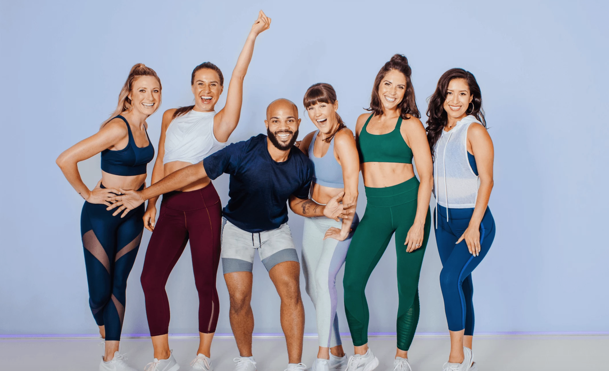 Fitness instructors pose in an advertisement for Obé.