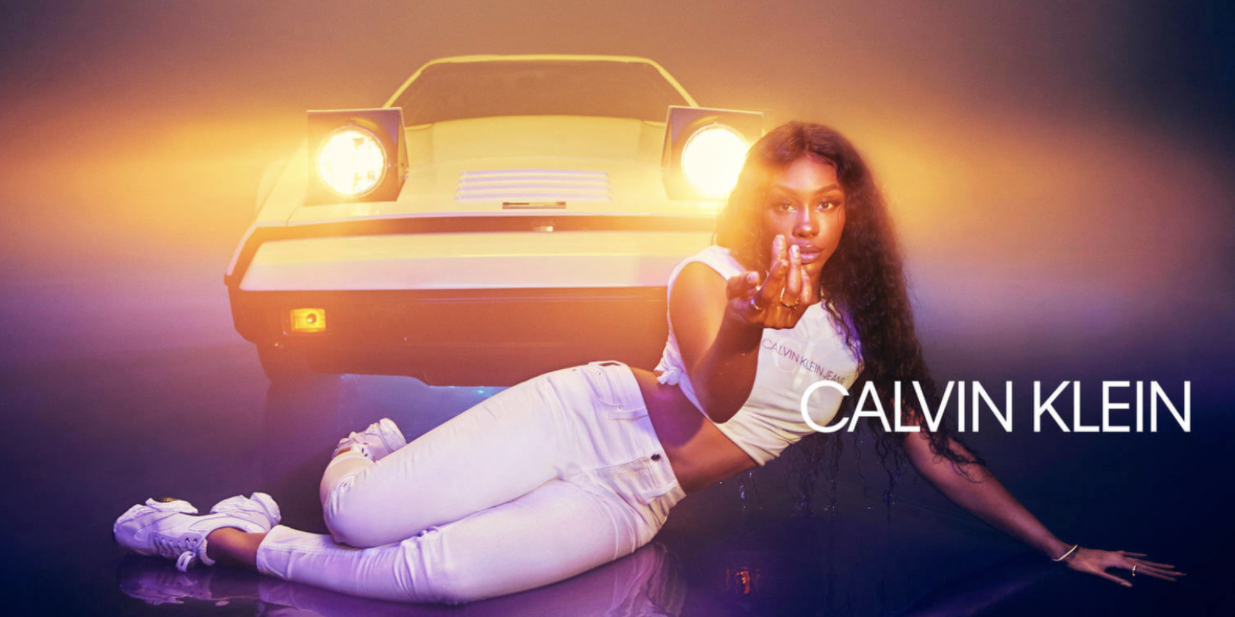 SZA poses in a Calvin Klein jeans advertisement.
