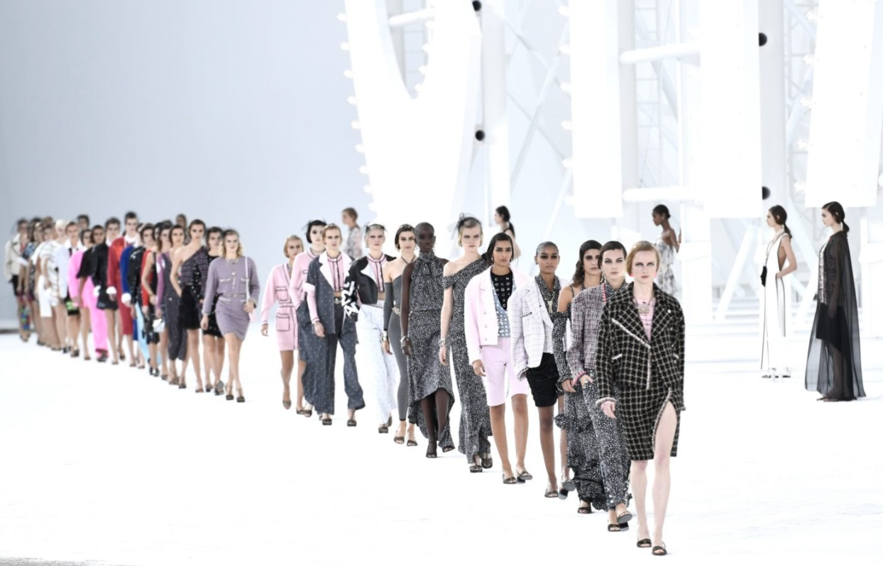 Models walking in luxury fashion brand Chanel's Spring 2021 show.